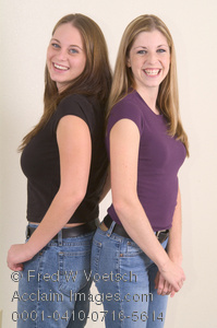 Clip Art Stock Photo of Two Girls Standing Back To Back
