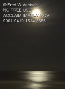 Clip Art Stock Photo of a Bright Moon Over The Ocean