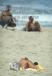 Clip Art Stock Photo of a Woman Tanning On a Beach