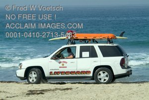 Lifeguard Driving 4wd On the Beach Clip Art Stock Photo