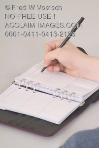 Writing In a Journal Or Planner - Clip Art Stock Photo