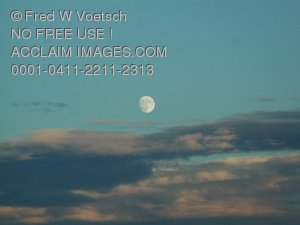 Clip Art Stock Photo of The Moon and Clouds In a Daylight Sky