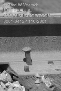 Black and White Stock Photo of a Spike In a Railroad Tie