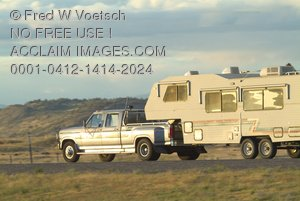 Clip Art Stock Photo of a Truck Pulling a Camper