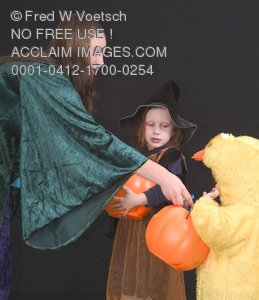 Halloween Stock Photo of a Woman Giving Out Candy