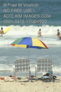 Clip Art Stock Photo of Beach Chairs and Umbrella On a Beach