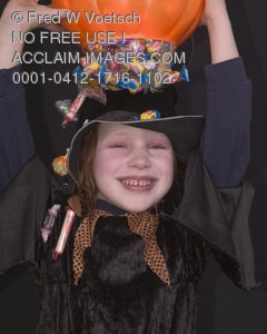 Clip Art Stock Photo of a Witch Pouring Candy On Her Head