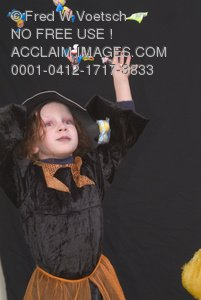 Clip Art Stock Photo of a Little Witch Throwing Candy In the Air