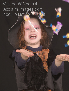 Stock Photo: Girl In a Witch Costume, Throwing Candy