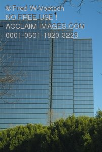 Clip Art Stock Photo of a Glass Building Reflecting the Blue Sky