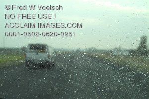 Clip Art Stock Photo of a View Through a Car Windshield on a Rainy Day