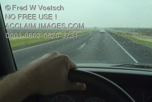 Clip Art Stock Photo of a Hand on the Steering Wheel