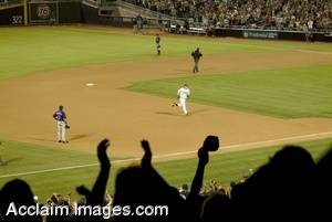 Baseball Stock Photo of a Batter Rounding the Bases After a Home Run