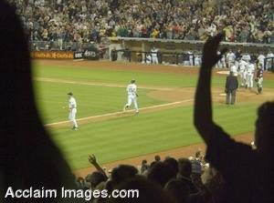 Stock Photo of Baseball Fans Cheering a Home Run