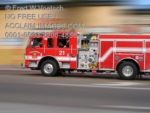 Fire Engine Racing Through Traffic Clip Art Stock Photo