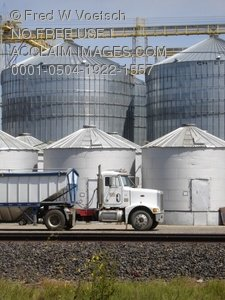 Silos and Truck Stock Photograph