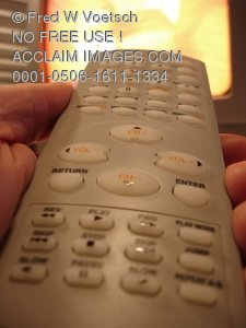 Clip Art Stock Photo of Person Pointing a Remote Controller at TV