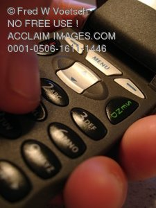 Clip Art Stock Photo of a Person Dialing Numbers on a Cell Phone