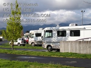 Clip Art Stock Photo of Recreational Vehicles Parked in a Parking Lot