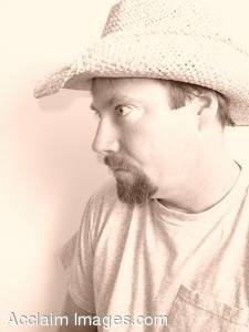 Stock Photo of a Man Wearing a Cowboy Hat