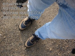 Clip Art Stock Photo of a Person Standing On Pavement