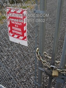 Clip Art Stock Photo of a Sign and Locked Chain Link Fence
