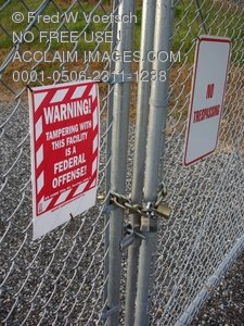 Clip Art Stock Photo of Warning Signs On a Chain Link Fence