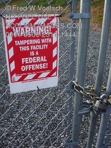 Stock Photo Clip Art of Warning Sign On a Chain Link Fence