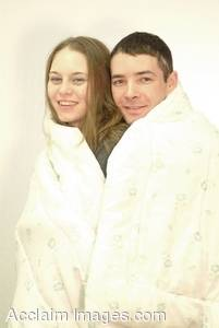 Stock Photo of a Couple Wrapped up in a Towel Together