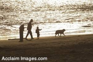 Stock Photo of a Family Walking On The Beach