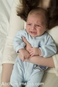 Stock Photo of a Newborn Baby Crying