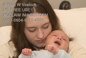 Stock Photo of a Young Mother With Her Newborn Baby