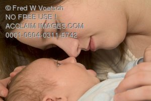 Clip Art Stock Photo of a Mother and Newborn Baby Sharing a Precious Moment