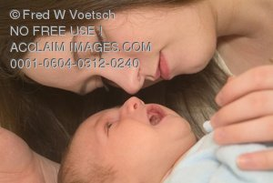 Clip Art Stock Photo of a Mother and Child In a Tender Moment