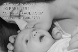 Clip Art Stock Photo of a Mother Kissing Her Newborn Baby