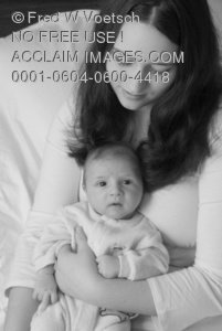 Clip Art Stock Photo of a Pretty Young Mother Looking Down at Her Baby Boy