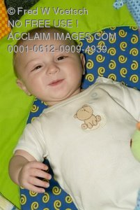 Clip Art Stock Photo of a Smiling Six Month Old Baby Boy with a Silly Smile