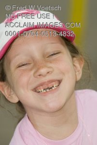 Clip Art Stock Photo of a 7 Year Old Girl With Missing Teeth Laughing and Smiling