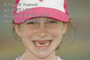 Clip Art Stock Photo of a 7 Year Old Girl With Missing Teeth and a Big Smile
