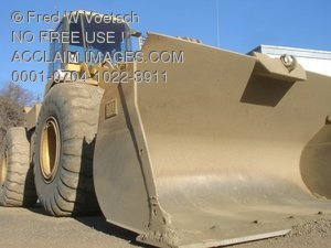 Stock Photograph of a Yellow Wheel Loader or Front Loader For Loading Gravel Into a Truck