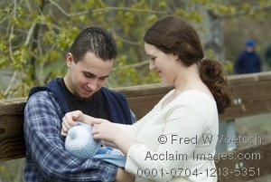 Clipart Stock Photo Showing a Young Family, Mother, Father and Newborn Baby out for a Walk on a Fall Day