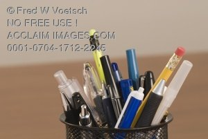Photo Clipart Image of Pens and Pencils in a Pen Holder on a Desk