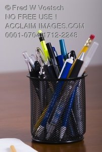 Stock Photo of a Variety of Pens and Pencils in Pen Holder
