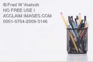 Stock Photo of Pens and Pencils in a Holder on an Office Desk with Room for Text