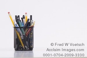 Stock Photograph of a Variety of Pens and Pencils in a Holder.