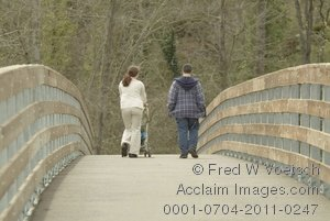 Stock Photo of a Young Couple Walking Acrossed a Bridge