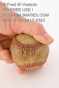 Stock Photo of a Mans Hand Holding a Dirty Old Baseball