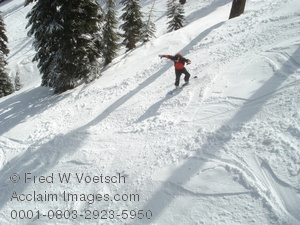 Stock Photo of a Snowboarder on a Steep Slope