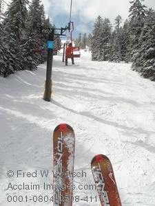 Stock Photography of Snowboarder and Skier Riding Chair Lift at Mt Ashland Oregon