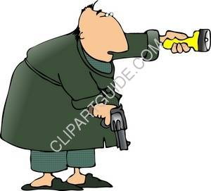 Man In A Robe Carrying A Gun And Flashlight